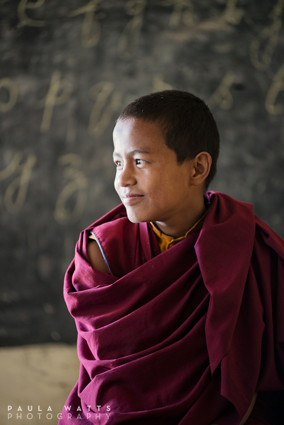 young Tibetan buddhist monk in classroom
